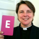 Rev Lucy Winkett holding the letter E