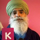 Ravi Singh, founder of Khalsa Aid, holding the letter K.