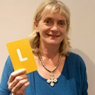 Alison Hilliard holding the letter L