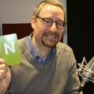 Rabbi Naftali Brawer in a radio studio with the letter N