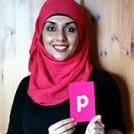 Ayisha Malik holding the letter P