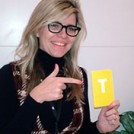Emma Barnett holding the letter T