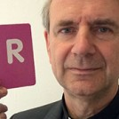 Fr Christopher Jamison holding the letter R