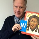 Ian Knowles with an icon and the letter W