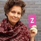 Sita Brand holding the letter Z