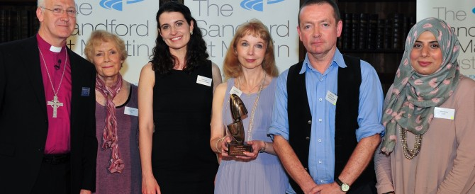 Kristine Pommert and the CTVC team receiving their Sandford St. Martin award